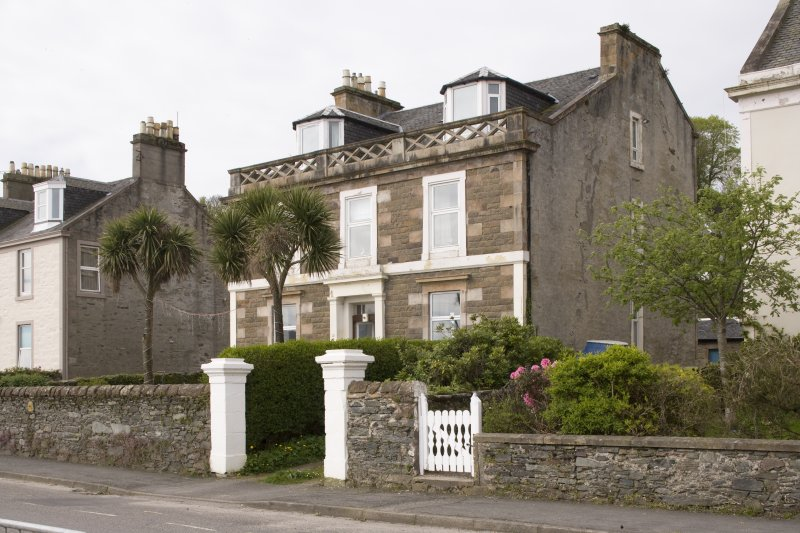 View of 22 and 23 Ardbeg Road, Ardbeg, Rothesay, Bute, showing stone balustrade at roofline