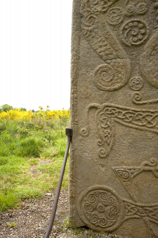 Detail of ogham inscription on left hand side of rear face of the Rodney Stone (daylight)