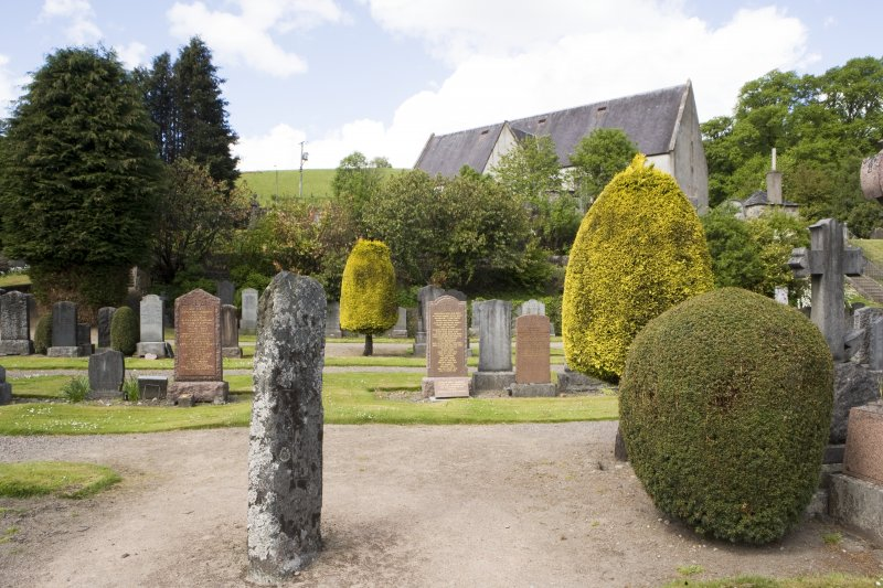 General view showing Pictish cross slab in churchyard
