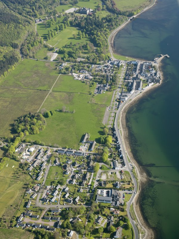 General oblique aerial view of the village of Inveraray with Newton in the foreground and Inveraray country house and policies beyond, taken from the SW.
