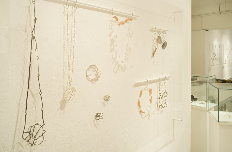 Detail of exhibits in the Silversmithing and Jewellery degree show, in the Newbery Tower ground floor exhibition area