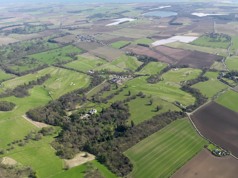 Oblique aerial view of Charleton Golf Course and Charleton House policies, taken from the NE.