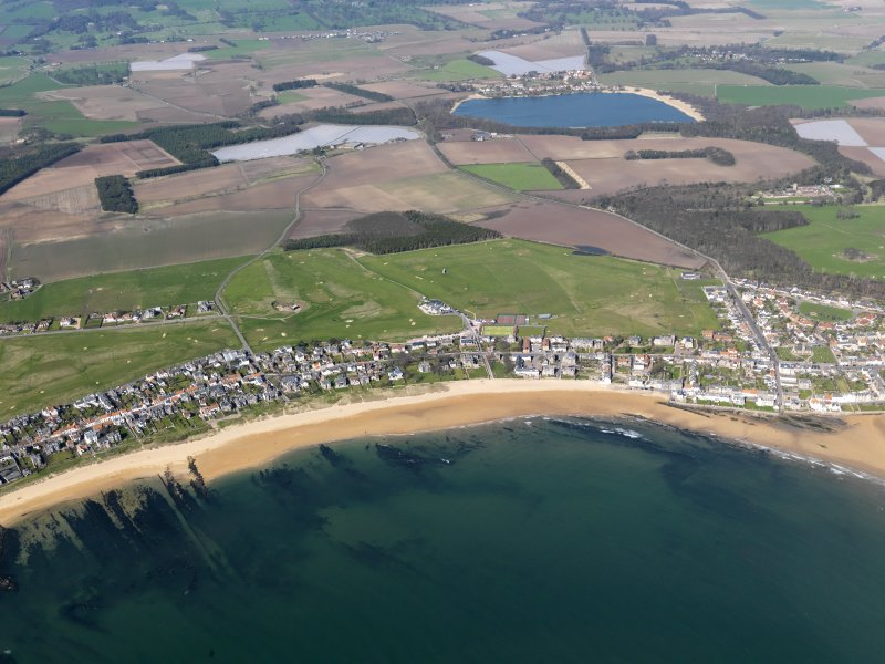 General oblique aerial view of Elie Golf Courses and the village with Kilconquhar Loch in the background, taken from the S.
