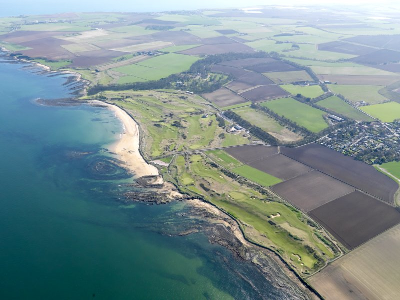 Oblique aerial view of Kingsbarns Golf Course, with the Cambo Estate beyond, taken from N.