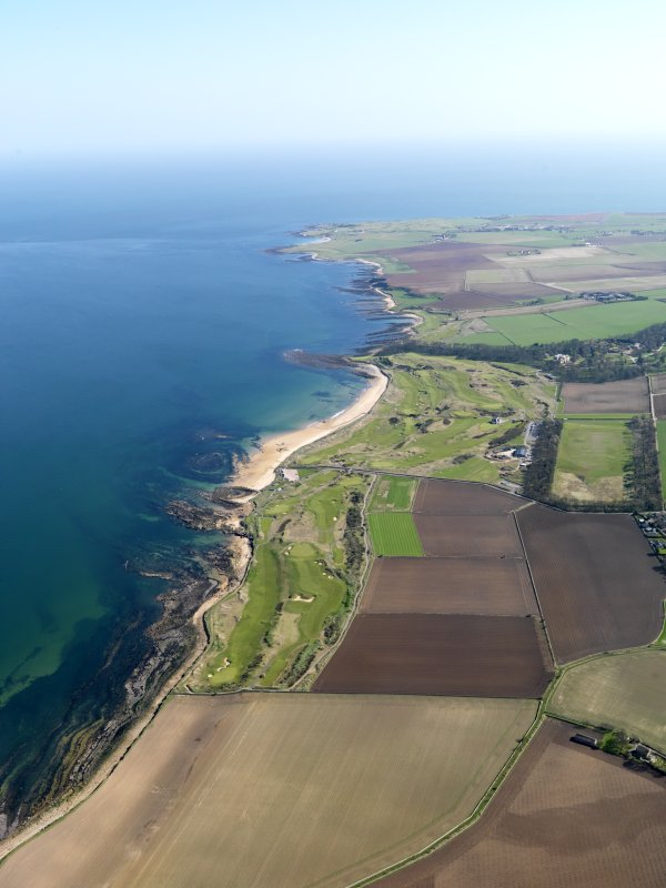 General oblique aerial view centred on Kingsbarns Golf Course, with the Cambo Estate beyond, taken from NW.