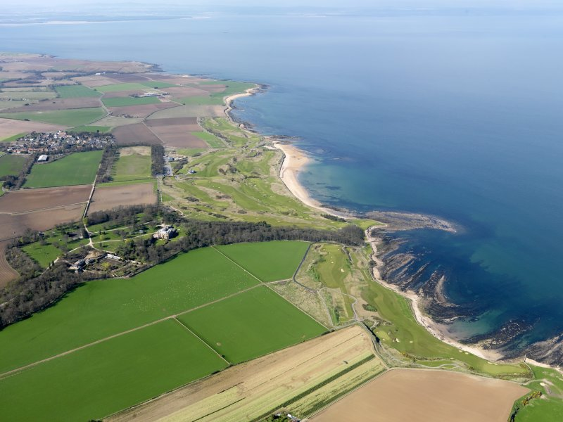 Oblique aerial view of Kingsbarns Golf Course, with the Cambo Estate to the foreground, taken from SE.