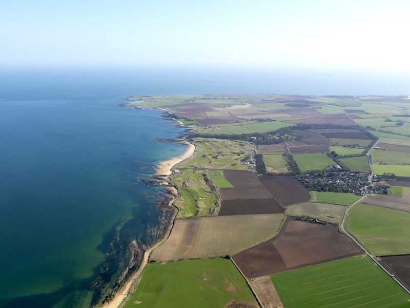 General oblique aerial view of Kingsbarns Golf Course and the village of Kingsbarns, with the Cambo Estate beyond, taken from NW.