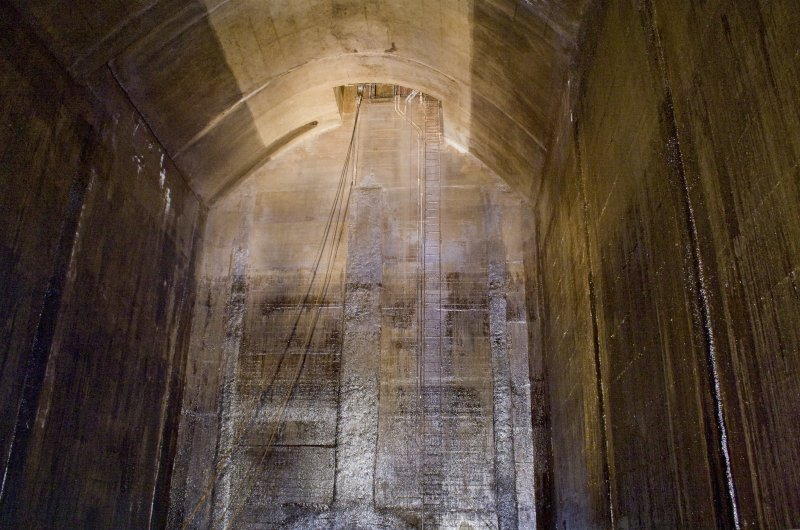 Interior. View of the ceiling at the SW end of tank 1, showing the location of the access platform and to the left is the  dipping hole marked by a smear of oil on the ceiling.