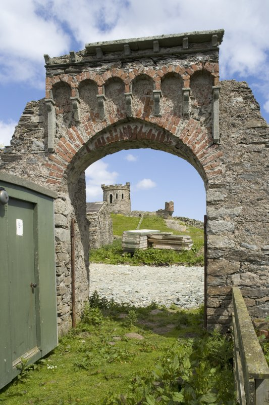 Decorative arch, view from W with tower on site of broch beyond