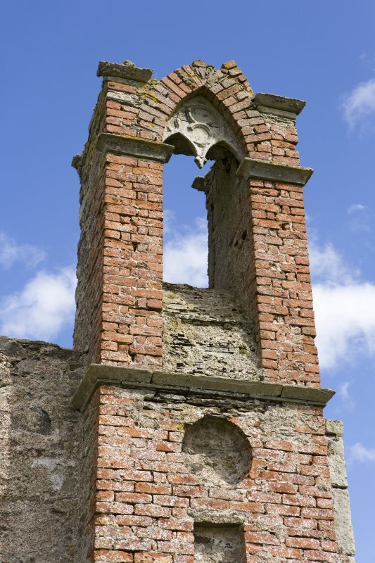 Bell tower, detail of arched window above entrance, Brough Lodge, Fetlar.