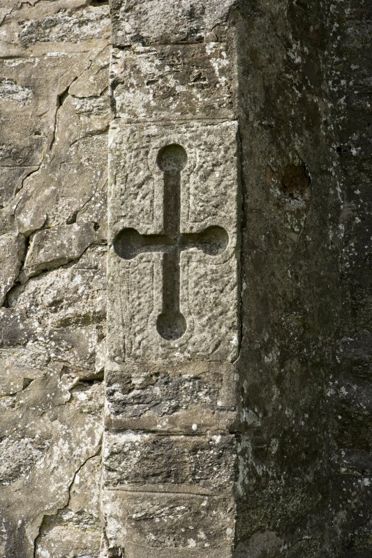 S facade, detail of carved cross with round terminals on buttress, Brough Lodge, Fetlar.