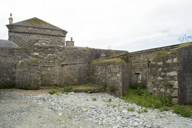 Outer courtyard to N of house, view of outbuildings from N
