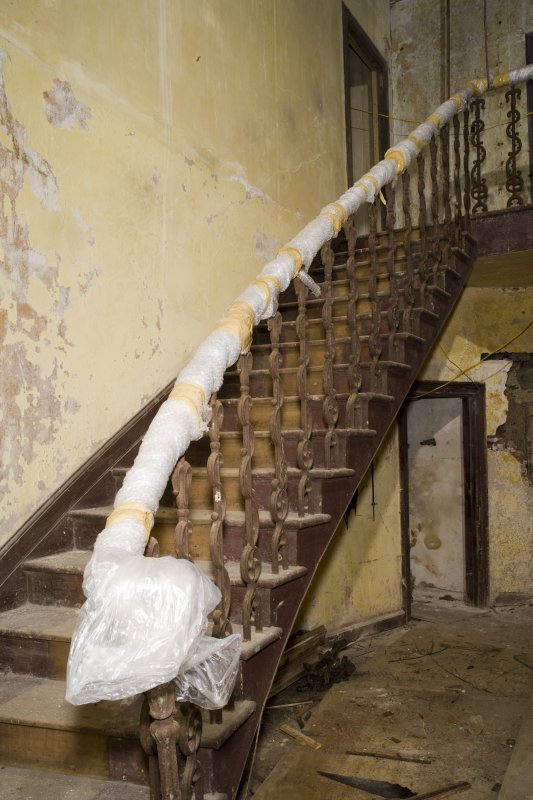 Interior. Ground floor, stair hall, view of staircase (bubble wrapped)