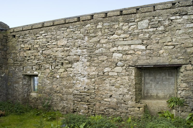 Interior. Bothy to N of main house, view of W wall showing blocked openings