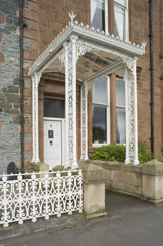 Detail of decorative ironwork porch at 1-5 Marine Court, Argyle Street, Rothesay, Bute