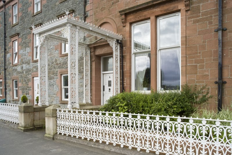 View from NNE of decorative ironwork porch and railings at 1-5 Marine Court, Argyle Street, Rothesay, Bute