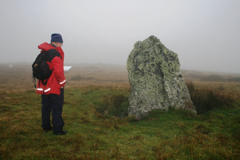 View showing the NNW face of the stone, with Mr Stratford Halliday, RCAHMS.