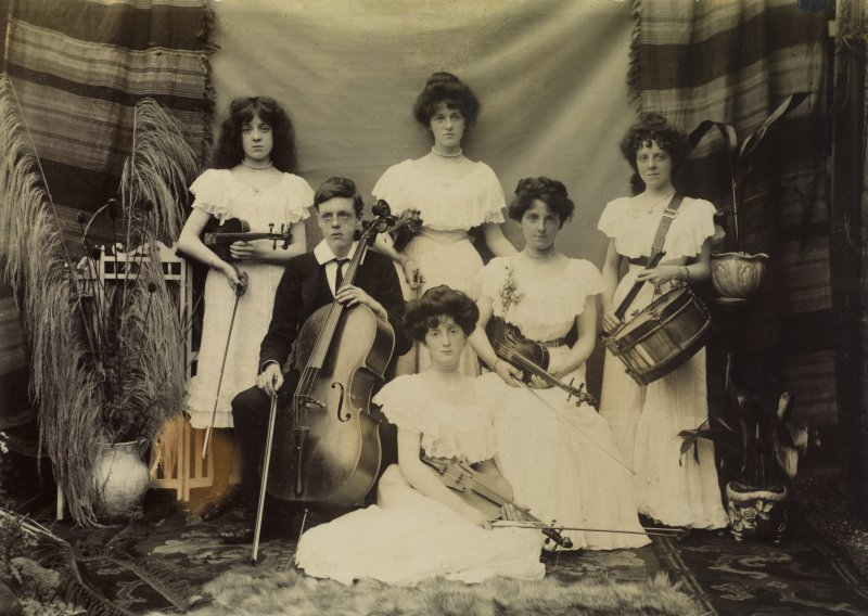 Photograph showing the Mather family with instruments