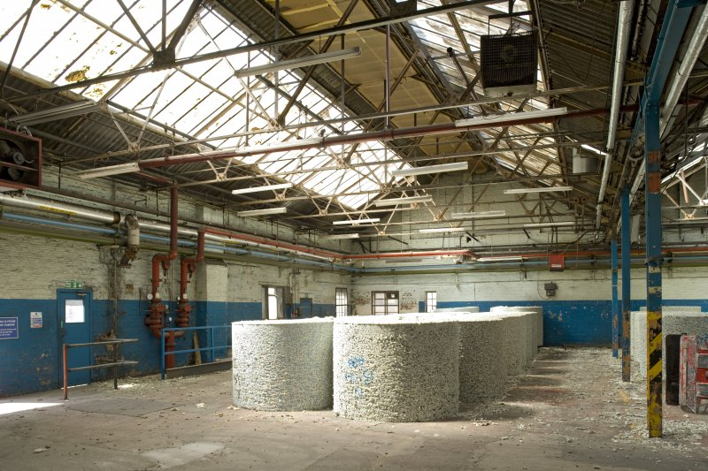 Interior. Foundry building from NNE showing the original west section. This area now houses machinery for cutting rubber bales into underlay.