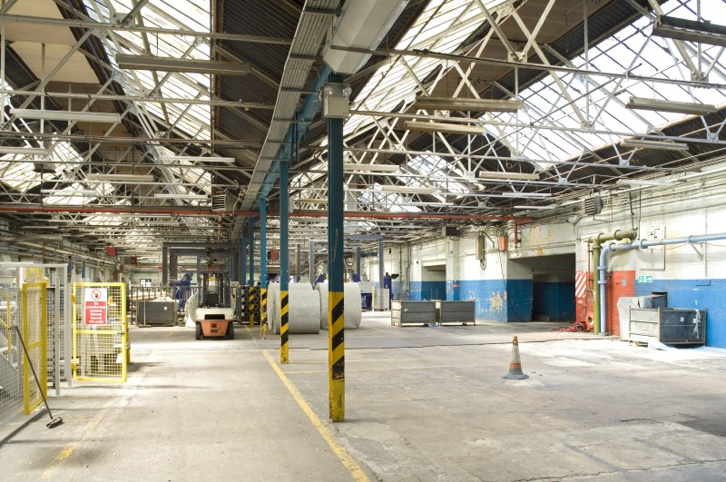 Interior. Foundry building from SE. Current machinery for cutting foam floor covering underlay. The area would have been divided into foundry area, power plant, plating and polishing when opened in 1913.