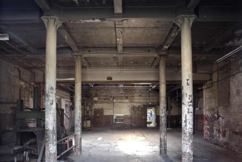 Interior. Former boiler room area, from S. Post 1913. Cast iron columns and concrete roof.