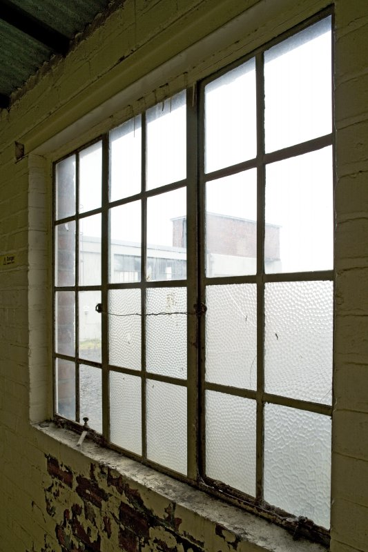 Interior. Main Building.  Third floor, view from SE corridor window between Wings D and E, 1915 extension. Wings D and E and their third floors were added when Heathhall undertook aero engine construction during the First World War.