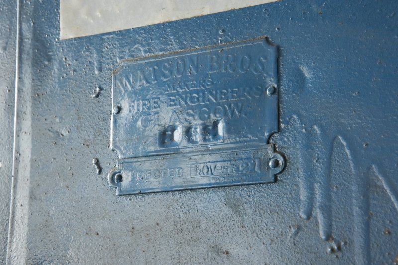 "Interior. Main Building, Second Floor, Wing C. Detail of makers plate inscribed ""Manufactured by Watson Bros, fire engineers, Glasgow. Erected Nov 1921"""