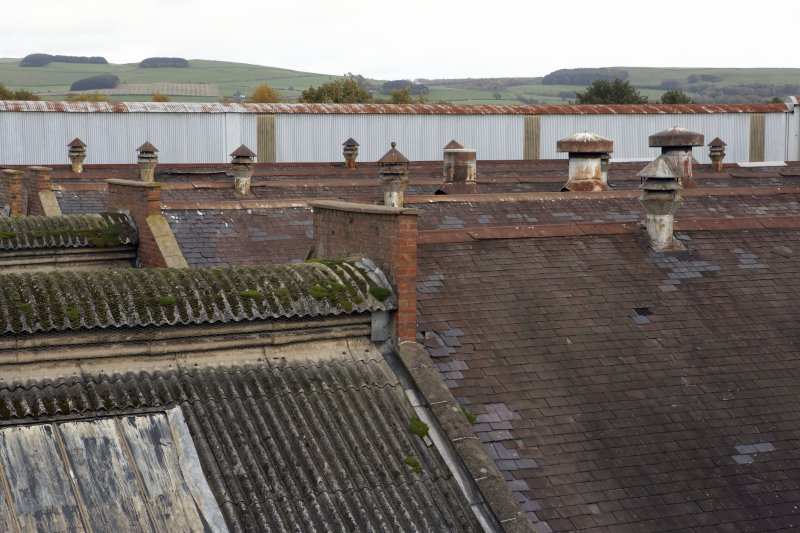 Detail view from S of rooftops of  post-1913 foundry building from Walkway between Wings C and D