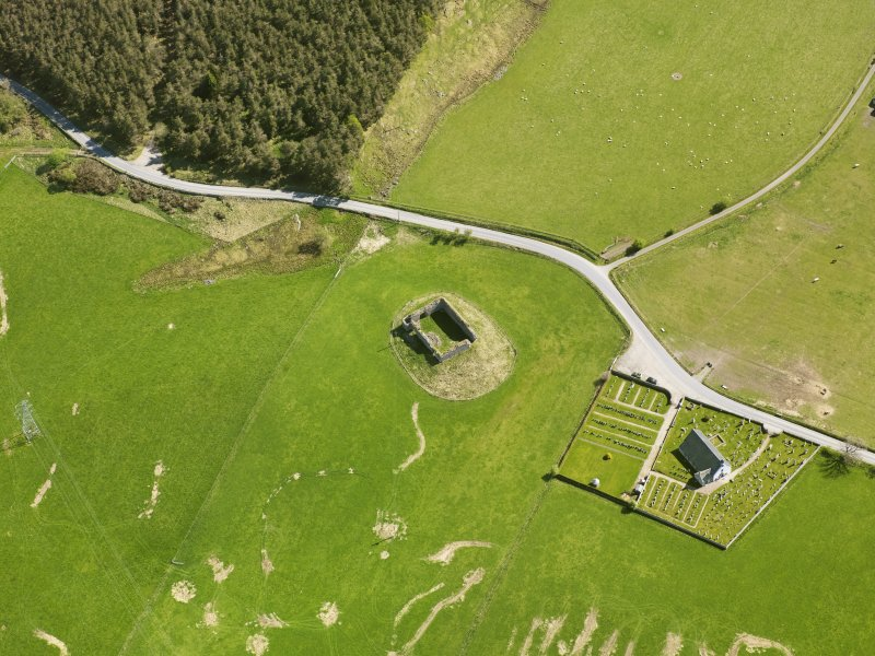 Oblique aerial view of Abernethy Parish Church and Castle Roy, taken from the W.