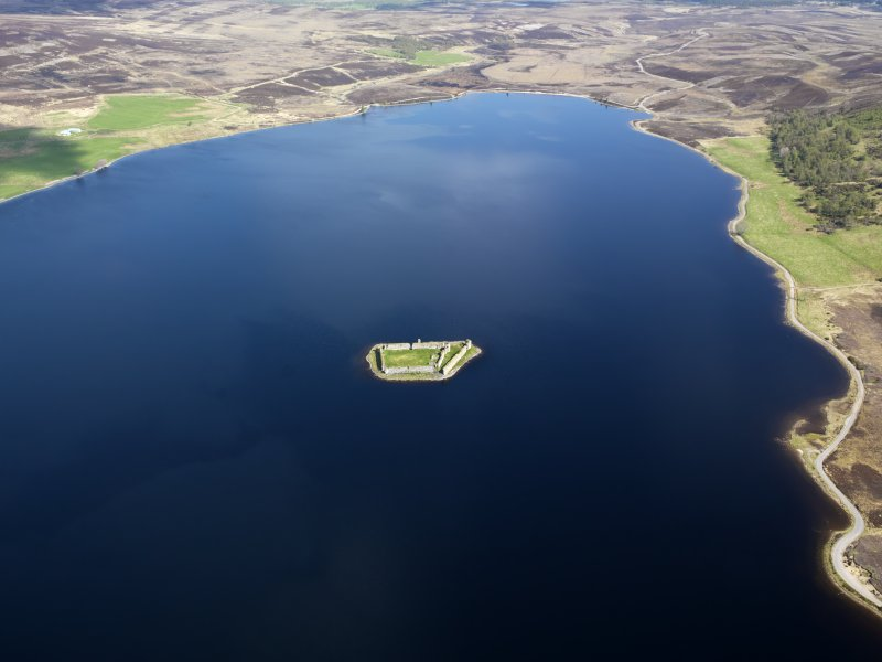 General oblique aerial view of Lochindorb Castle, taken from the SSW.