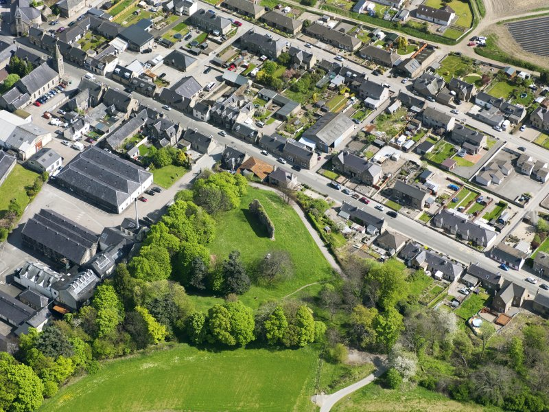 Oblique aerial view of Rothes Castle and Glen Spey Distillery, taken from the WSW.