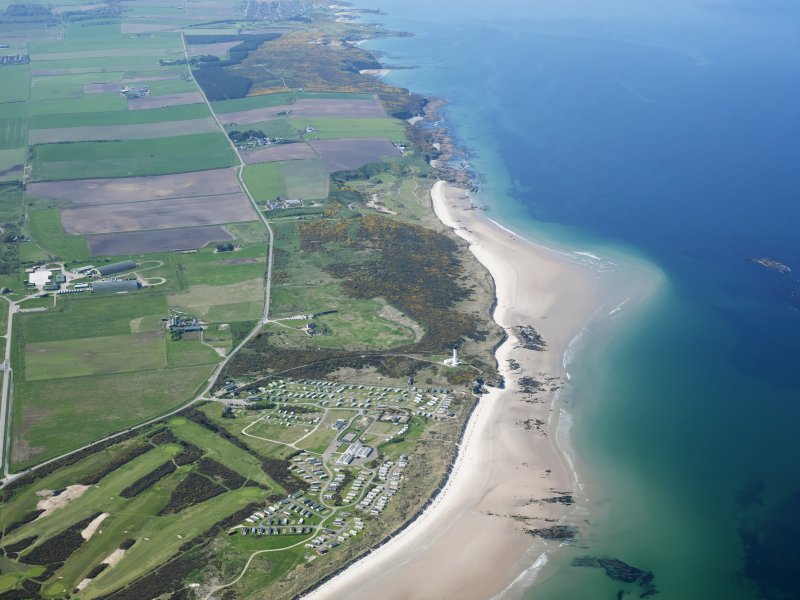 General oblique aerial view of Moray Golf Course and Covesea Village, taken from the E.
