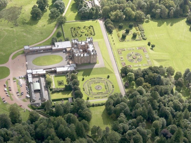 Oblique aerial view of Drumlanrig Castle and gardens, taken from the WNW.