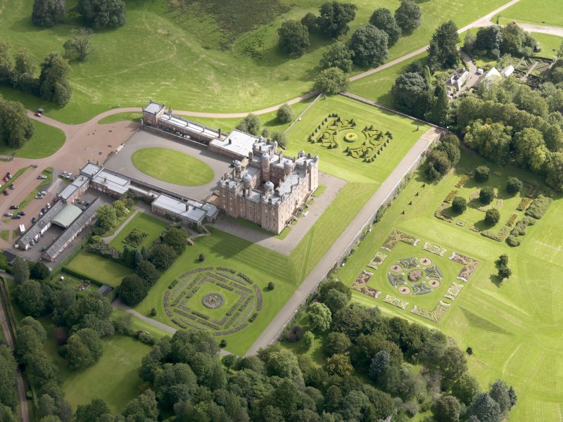 Oblique aerial view of Drumlanrig Castle and gardens, taken from the WSW.