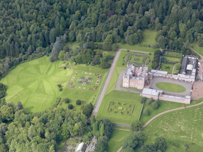 Oblique aerial view of Drumlanrig Castle and gardens, taken from the ENE.