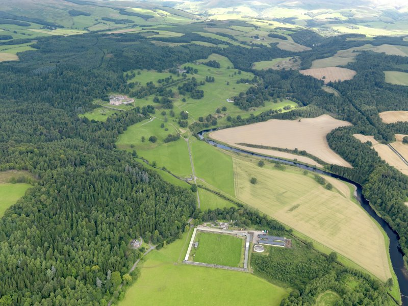 General oblique aerial view of Drumlanrig Estate and policies looking up the River Nith, taken from the SSE.