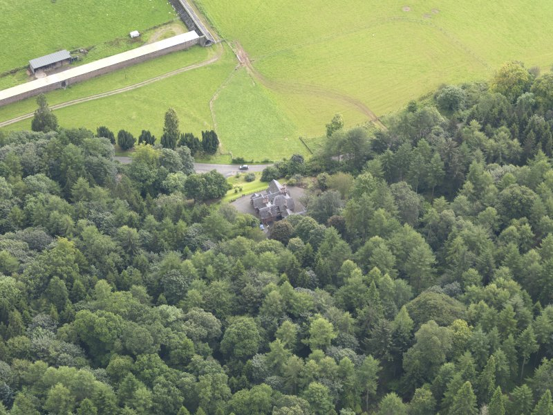 Oblique aerial view of Drumlanrig Estate Low Gardens House, taken from the WNW.