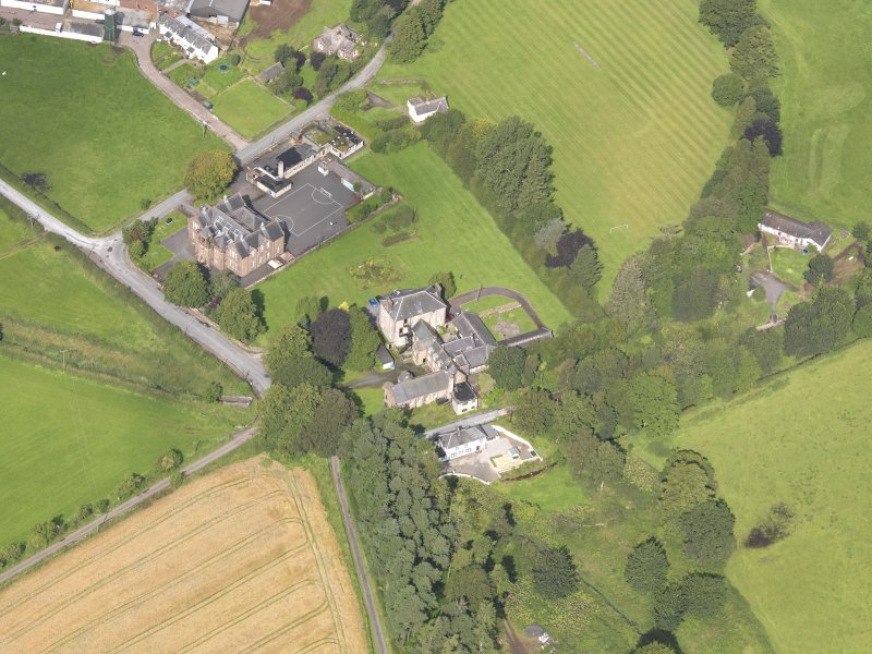 Oblique aerial view of Wallacehall Academy and Closeburn School, taken from the ESE.