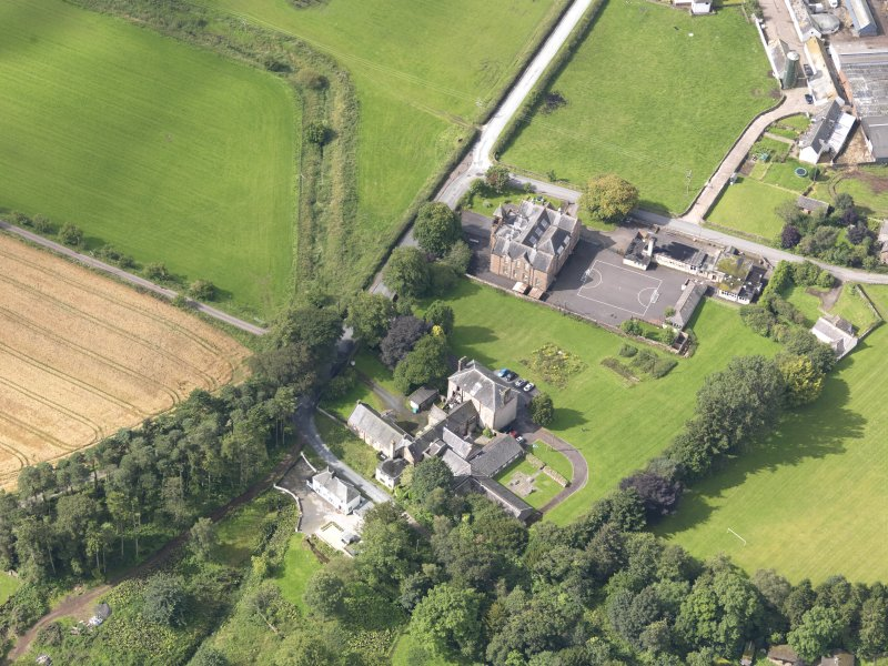 Oblique aerial view of Wallacehall Academy and Closeburn School, taken from the NE.