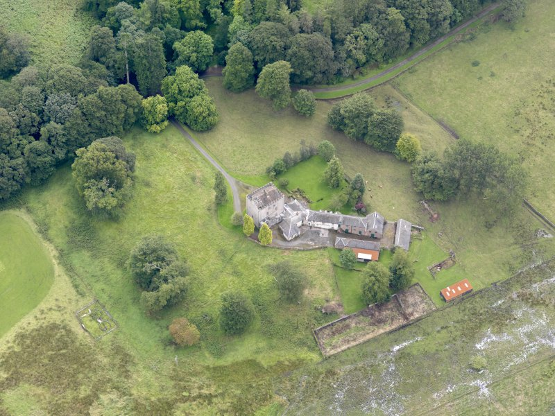 Oblique aerial view of Closeburn Castle, taken from the NW.