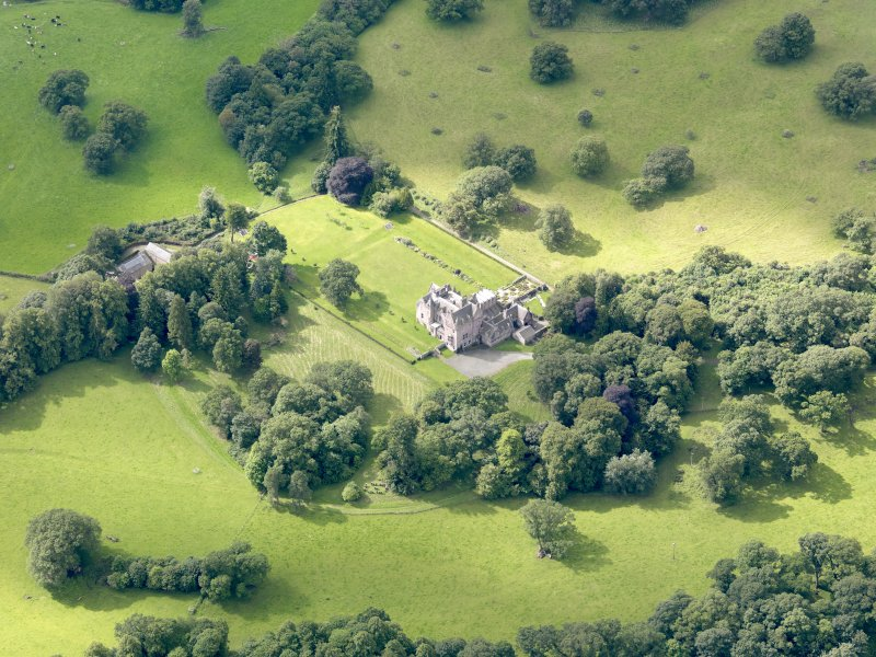 Oblique aerial view of Capenoch House and stables, taken from the NNE.
