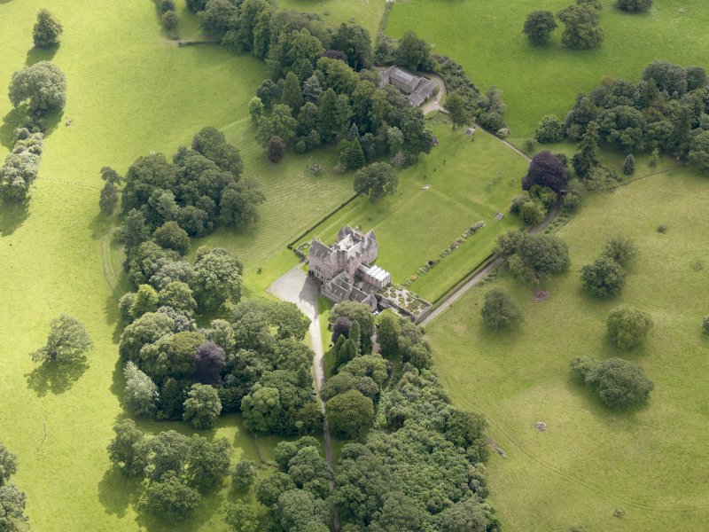 Oblique aerial view of Capenoch House and stables, taken from the NW.