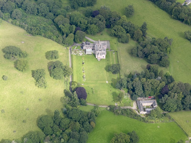 Oblique aerial view of Capenoch House and stables, taken from the SSE.