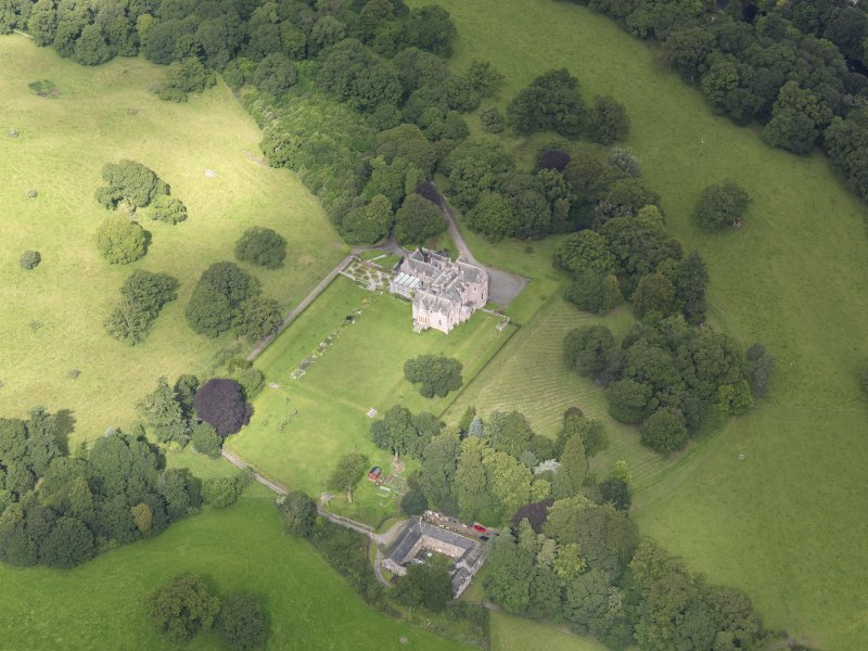 Oblique aerial view of Capenoch House and stables, taken from the SE.