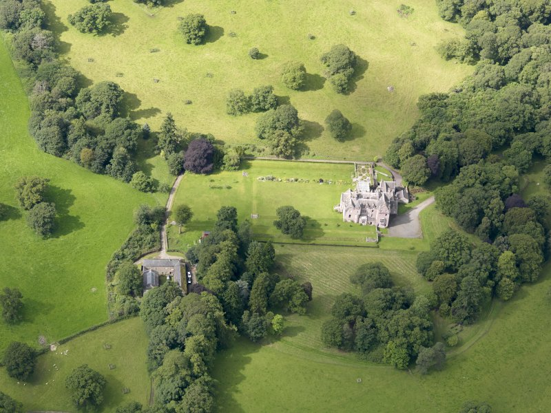 Oblique aerial view of Capenoch House and stables, taken from the ENE.