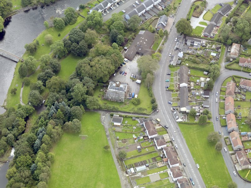 Oblique aerial view of Newton Stewart, centred on Douglas House, taken from the NW.