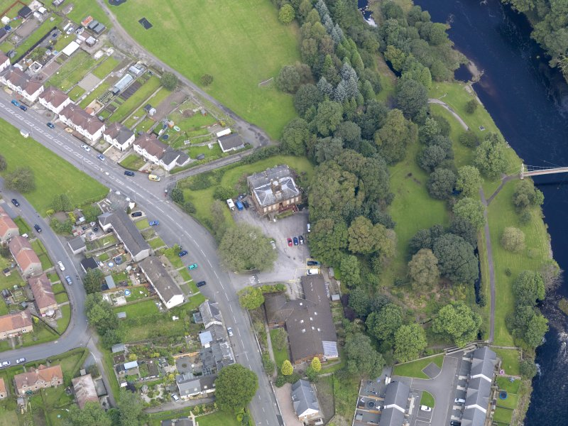 Oblique aerial view of Newton Stewart, centred on Douglas House, taken from the SSW.