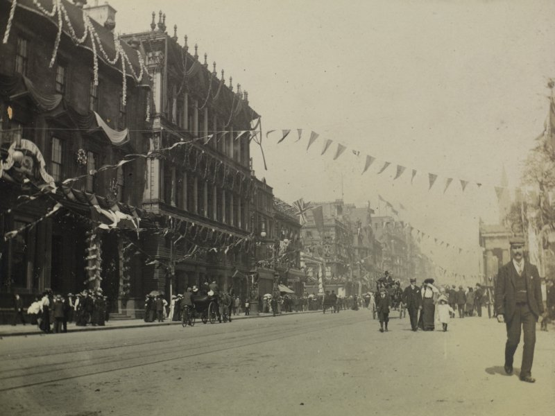 Princes Street looking east from outside No 85 showing bunting for the coronation of Edward VII.  View also shows pedestrians and  horse-drawn carriages. PHOTOGRAPH ALBUM NO 76: THE CORONATION ALBUM VOL.2