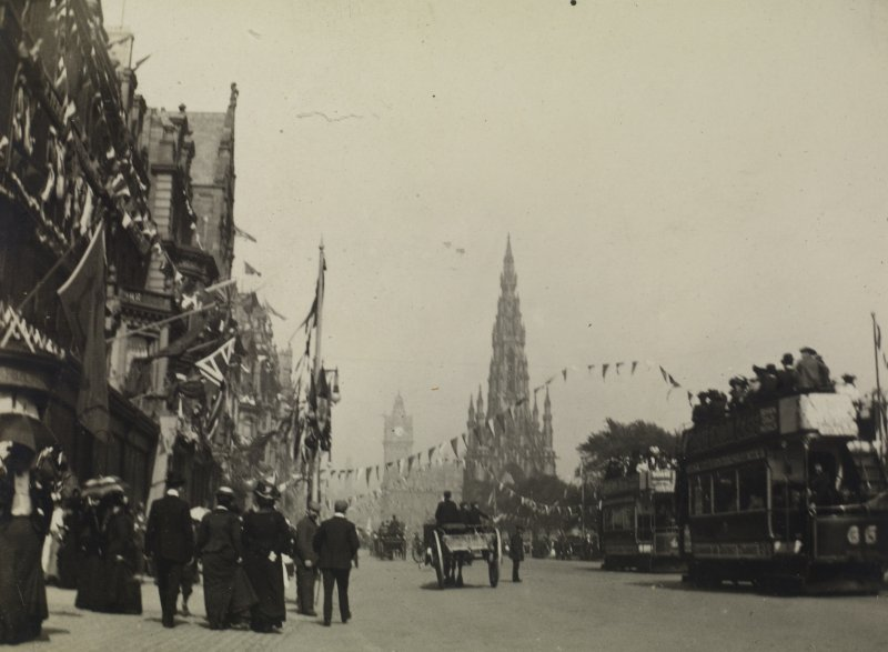 Princes Street looking east from outside No 70 showing bunting for the coronation of Edward VII.  View also shows pedestrians, horse-drawn carts/carriages and trams. Copied from PHOTOGRAPH ALBUM NO 76: THE CORONATION ALBUM VOL.2