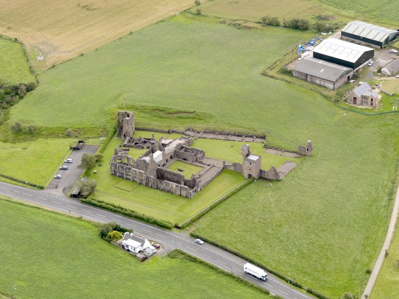 Oblique aerial view of Crossraguel Abbey, taken from the NW.